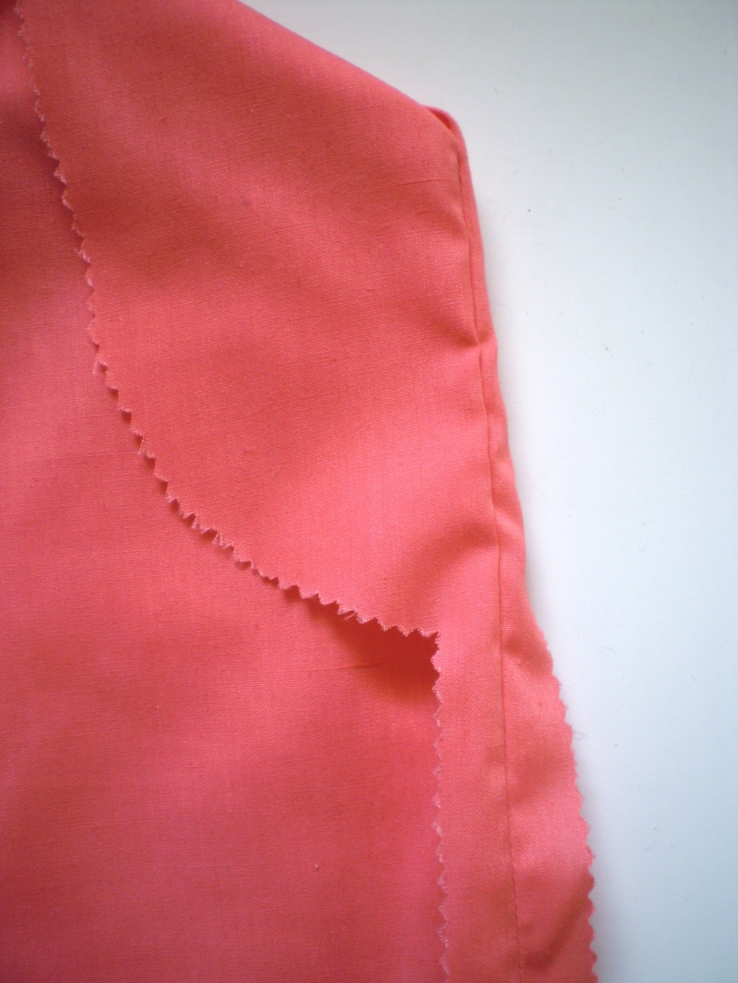 If you don't have a serger, finish seams with pinking shears instead. It's much cheaper!