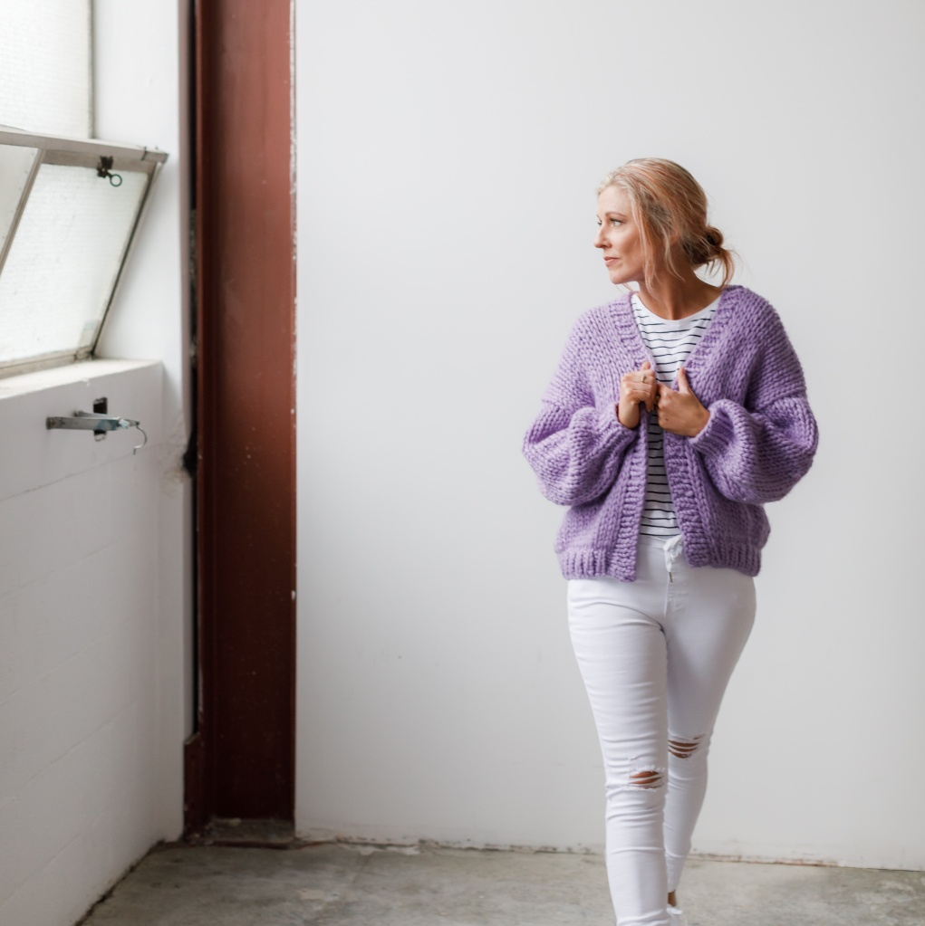 Woman wearing a chunky hand knit cardigan