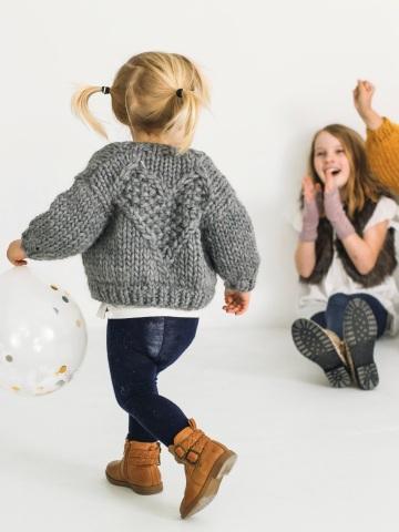 Kid wearing Mini Love Bomber knitting pattern